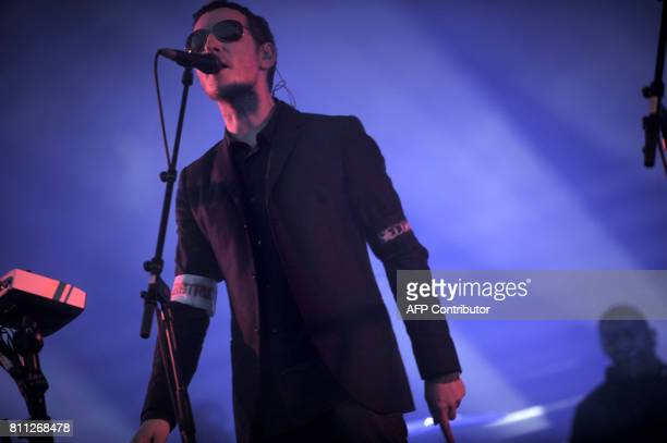 English artist Robert del Naja performs on stage with his band Massive Attack on July 04 2008 in Belfort eastern France during the 20th edition of...