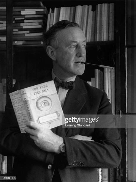 English author Ian Fleming in his study with a copy of 'For Your Eyes Only' one of the series of James Bond novels that he wrote