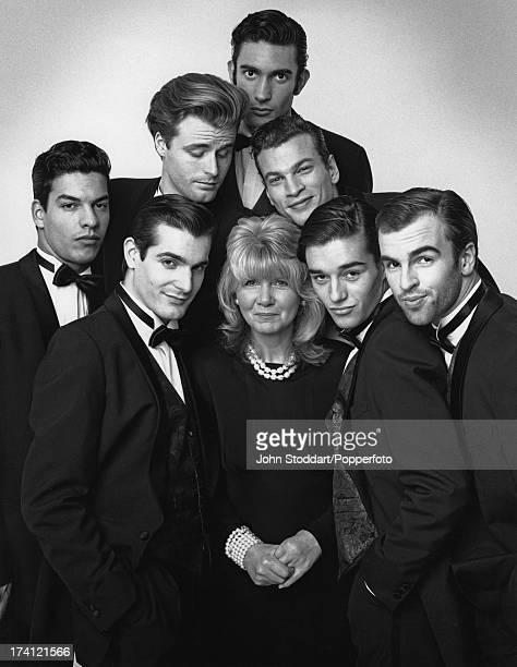 English author Jilly Cooper surrounded by young men 1993
