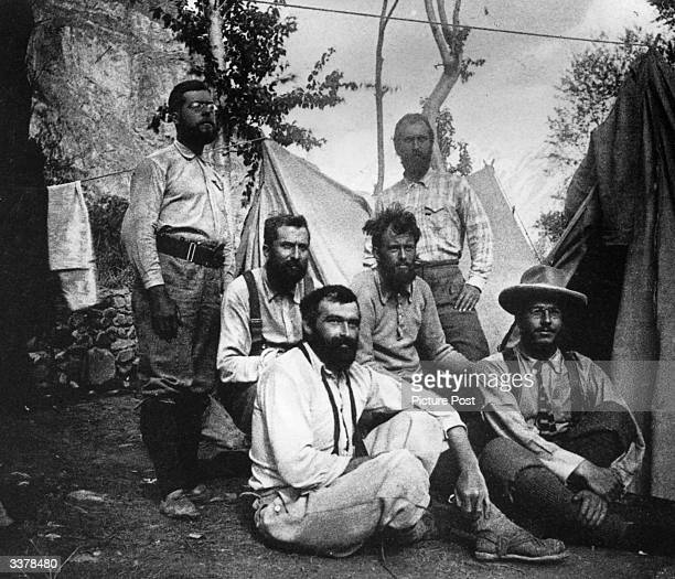 English author occultist magician and mountaineer Aleister Crowley with companions during an expedition Original Publication Picture Post 8183 New...