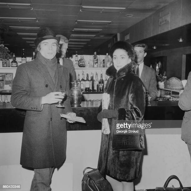 English ballerina Margot Fonteyn and Soviet ballet dancer Rudolf Nureyev have a drink on St Patrick's Day while at Heathrow Airport London UK 18th...