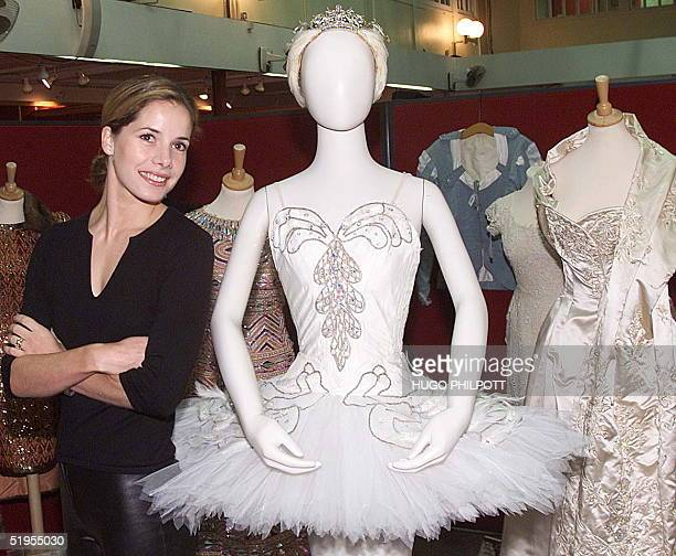 English Ballet star Darcey Bussell stands 02 November 2000 next to a tutu which was worn by Dame Margot Fonteyn in the 1963 production of 'Swan Lake'...
