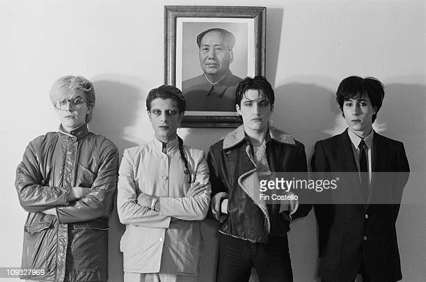 English band Japan posed standing in front of a portrait of Chairman Mao during the Tin Drum sessions in London in September 1981 LR David Sylvian...