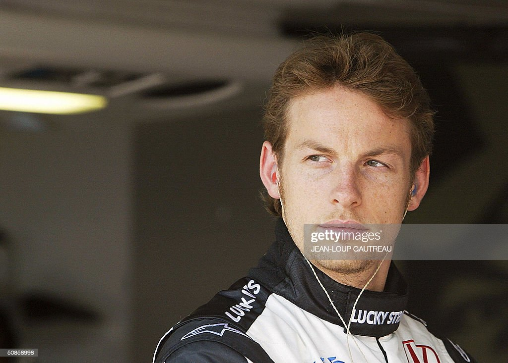 English BAR-Honda driver Jenson Button waits in the pits of the Monte-Carlo racetrack during the first free practice session three days before the Monaco Grand Prix, 20 May 2004 in Monaco.