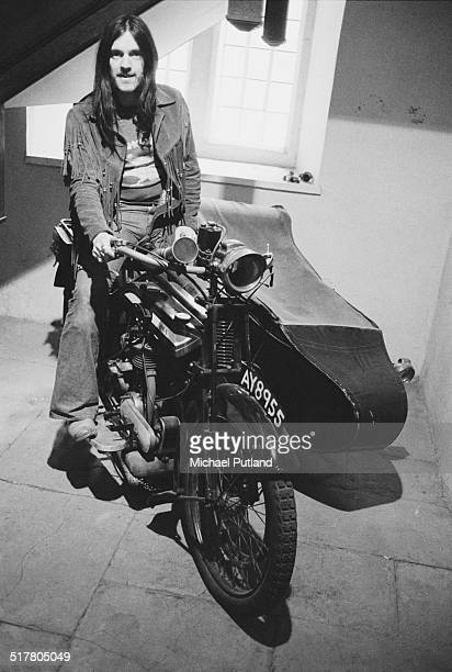 English bassist and singer Ian 'Lemmy' Kilmister of space rock group Hawkwind sitting on a BSA motorcycle and sidecar combination 10th May1974