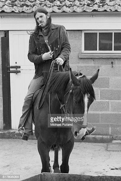 English bassist and singer Ian 'Lemmy' Kilmister of space rock group Hawkwind on horseback 10th May1974