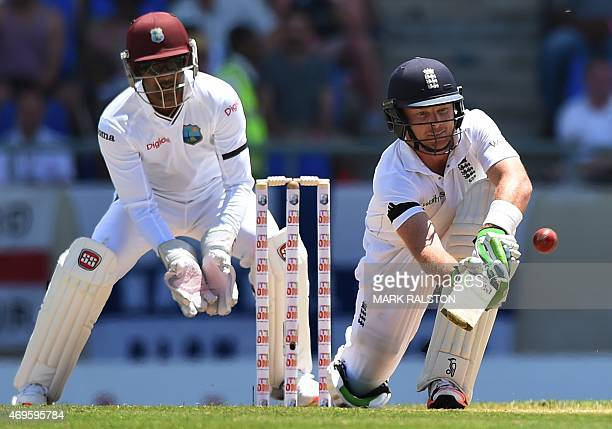 English batsman Ian Bell plays a sweep shot off the bowling of Kemar Roach during day one of the first test match between West Indies and England at...