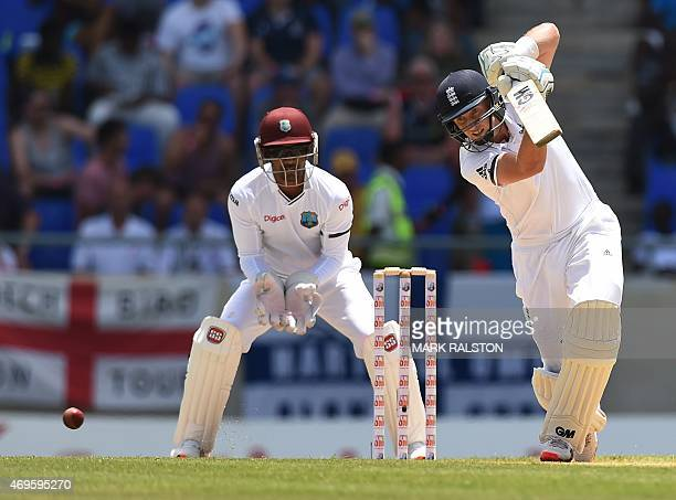 English batsman Joe Root plays a shot off the bowling of Kemar Roach during day one of the first test match between West Indies and England at the...
