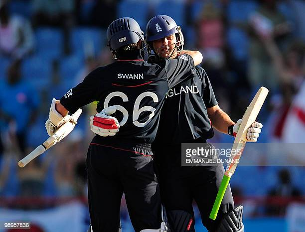 English batsman Tim Bresnan is congratulated by teammate Graeme Swann after hitting England's winning run during the ICC World Twenty20 Super Eight...