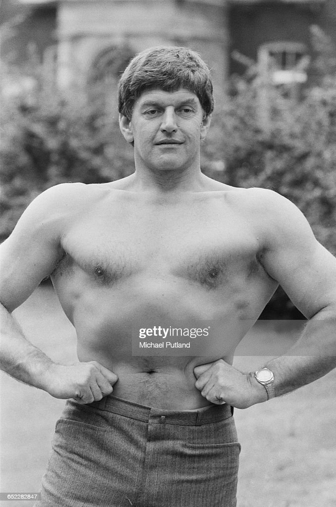 English bodybuilder and actor, Dave Prowse, flexes his muscles, 23rd July 1981. Prowse is best known for playing Darth Vader in the original 'Star Wars' trilogy.