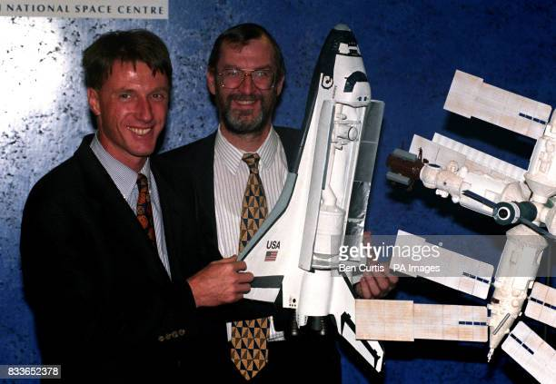 English born Astronaut Michael Foale and Space Minister John Battle holds models of the Mir Space Station and a US Space Shuttle to mark their...