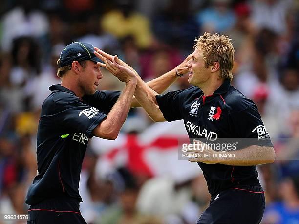 English bowler Luke Wright celebrates with Stuart Broad who caught the ball to dismiss Australian batsman Cameron White during the Men's ICC World...