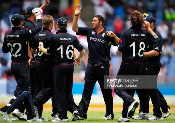 English bowler Tim Bresnan celebrates with teammates after taking the wicket of Sri lankan batsman Tillakaratne Dilshan during the ICC World Twenty20...
