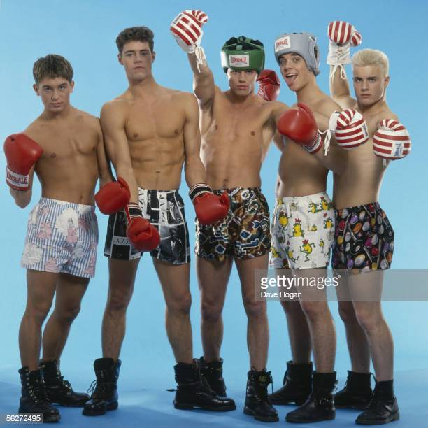 English boy band Take That pose in combat boots boxer shorts and red boxing gloves as worn in their first video 'Do What You Like' 1991 From left to...