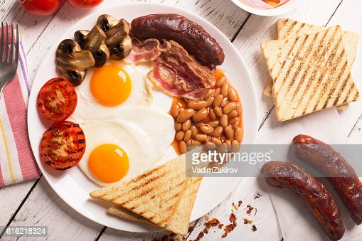 English breakfast on a white wooden surface : Stock Photo