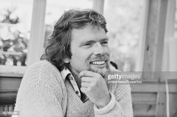 English businessman and owner of Virgin Records Richard Branson pictured sitting in his houseboat on the Grand Union canal in London on 26th May 1982