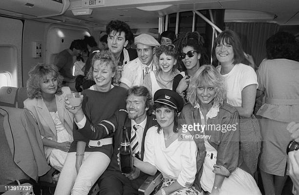 English businessman Richard Branson celebrates the first flight of his Virgin Atlantic airline with a group of celebrities London 23rd June 1984...