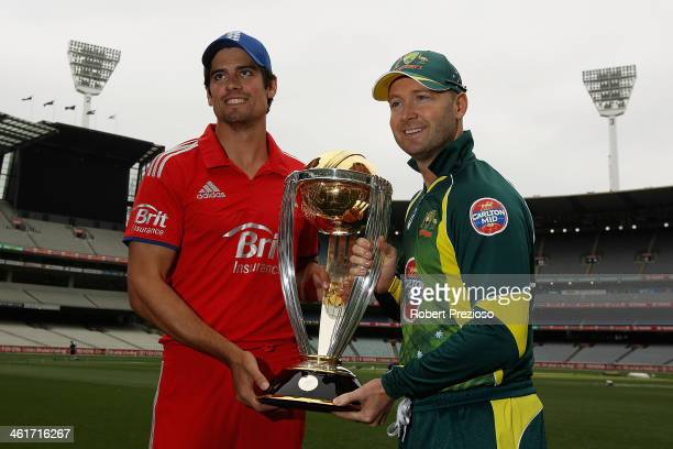 English captain Alastair Cook and Australian captain Michael Clarke pose with the World Cup trophy during the One Day International media session at...