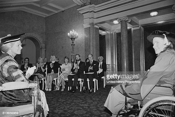 English cellist Jacqueline du Pre receives a honorary degree from Katharine Duchess of Kent during a ceremony at Lancaster House in London on 16th...