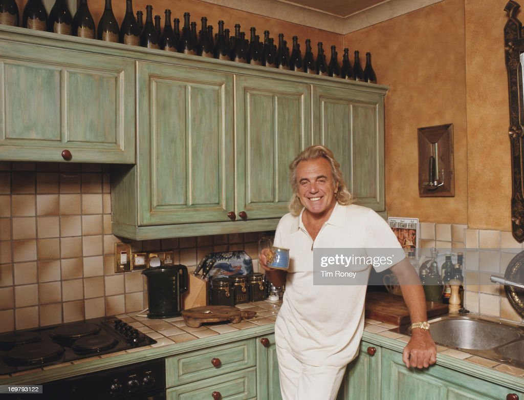 English club owner Peter Stringfellow in the kitchen, circa 1990.