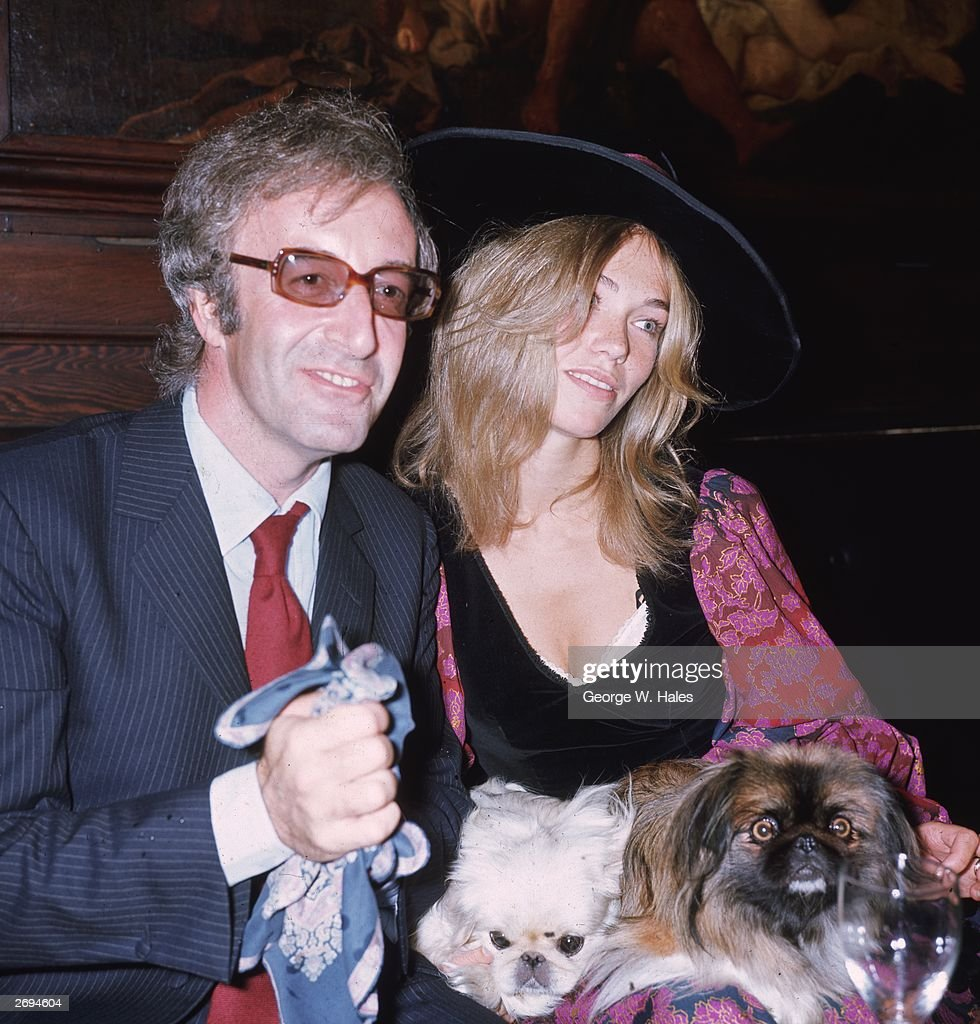 English comedian and actor Peter Sellers with his third wife, Miranda Quarry, the stepdaughter of Lord Mancroft, deputy chairman of Cunard's, at their wedding reception at 'Tramp' in Jermyn Street, with Miranda's two pekinese dogs.