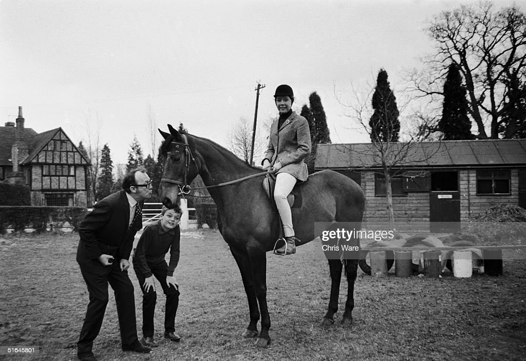 English comedian Eric Morecambe (1926 - 1984) at his home in Harpenden, Hertfordshire with his son 13 year old son Gary and 15 year old daughter Gail, who is riding her pony, 17th April 1969.