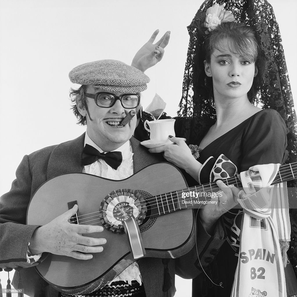 English comedian <a gi-track='captionPersonalityLinkClicked' href=/galleries/search?phrase=Eric+Morecambe&family=editorial&specificpeople=215236 ng-click='$event.stopPropagation()'>Eric Morecambe</a> (1926 - 1984) with a lady in Spanish dress, promoting the FIFA World Cup in Spain, 8th February 1982.