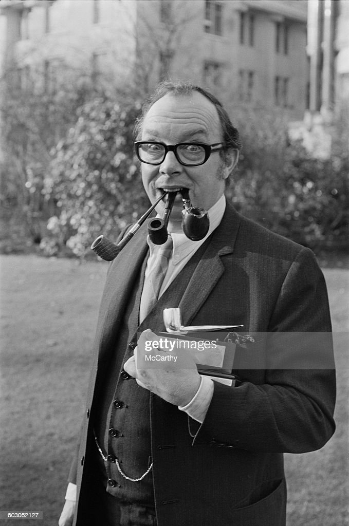 English comedian <a gi-track='captionPersonalityLinkClicked' href=/galleries/search?phrase=Eric+Morecambe&family=editorial&specificpeople=215236 ng-click='$event.stopPropagation()'>Eric Morecambe</a> (1926 - 1984) with his Pipeman of the Year award, UK, 20th January 1971. The event was later titled Pipe Smoker of the Year. The runner-up was Lord Shinwell, who won the following year.
