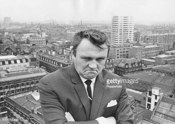 English comedian Les Dawson scowls on a rooftop 18th August 1967