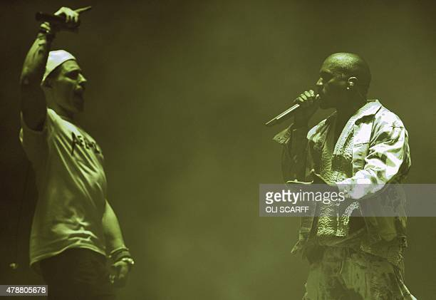 English comedian Simon Brodkin playing his character Lee Nelson interrupts American singer Kanye West has he performs on the Pyramid Stage at the...
