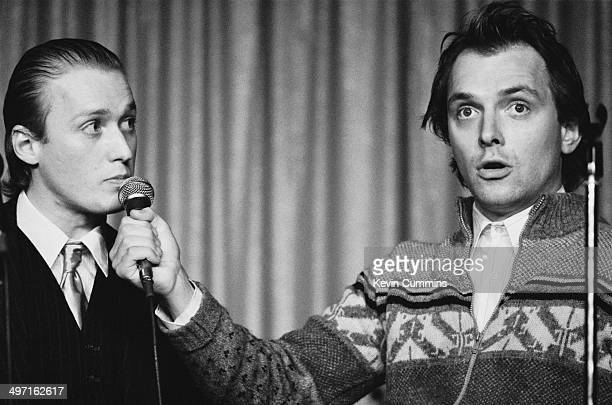 English comedians and actors Adrian Edmondson as Vyvyan and Rik Mayall as Rick in a stage version of the television sitcom 'The Young Ones'...