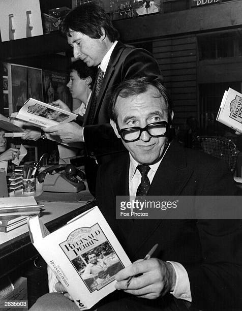 English comedy actor Leonard Rossiter signing copies of 'The Better World of Reginald Perrin' a novelisation of series three of the TV sitcom 'The...