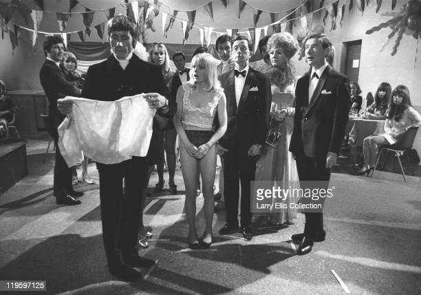 English comedy actors Jim Dale Charles Hawtrey Joan Sims and Kenneth Williams film a scene for the comedy 'Carry on Again Doctor' 1969