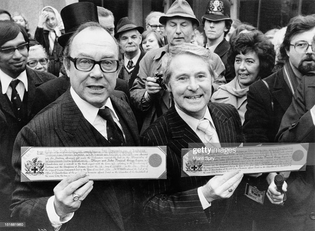 English comedy double act <a gi-track='captionPersonalityLinkClicked' href=/galleries/search?phrase=Eric+Morecambe&family=editorial&specificpeople=215236 ng-click='$event.stopPropagation()'>Eric Morecambe</a> (1926 - 1984, left) and <a gi-track='captionPersonalityLinkClicked' href=/galleries/search?phrase=Ernie+Wise&family=editorial&specificpeople=211147 ng-click='$event.stopPropagation()'>Ernie Wise</a> (1925 - 1999) outside the Guildhall with their certificates after receiving the Freedom of the City of London, 1st December 1976.
