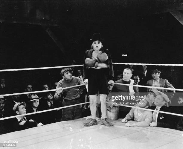 English comic actor and director Charlie Chaplin waiting in his corner in the famous boxing scene from the film 'City Lights'
