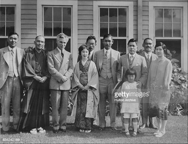 English comic actor and filmmaker Charlie Chaplin poses with a group of Japanese Kengeki players from the Imperial Theatre in Tokyo circa 1928 He was...