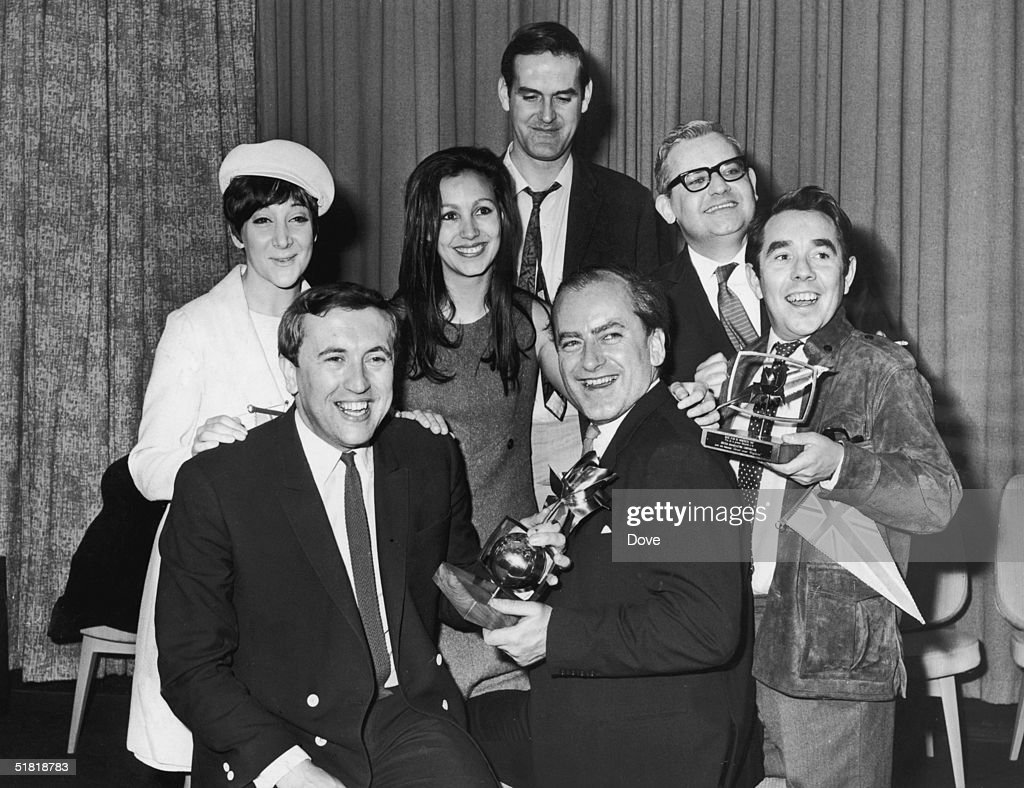 English comic actor and writer John Cleese with other cast members of the television comedy programme 'Frost Over England' after the show won the...