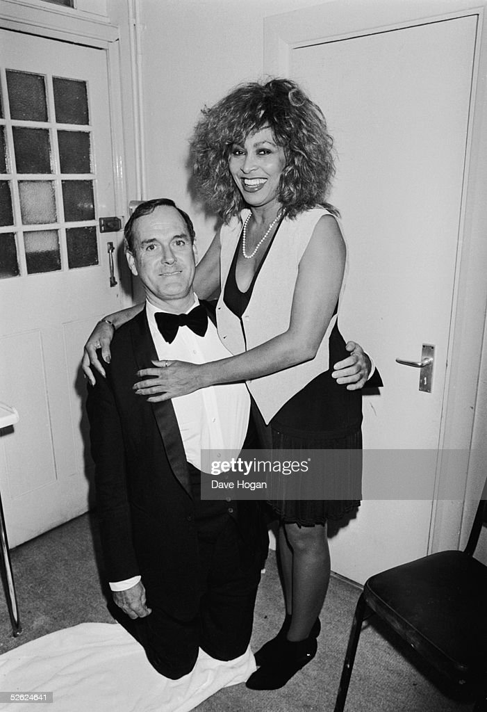 English comic actor John Cleese with American singer Tina Turner at a party to celebrate the Hysteria 2 Aids charity show, October 1989.