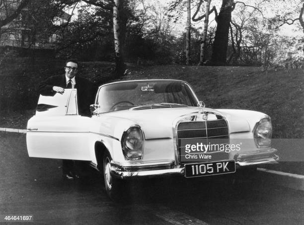 English comic actor Peter Sellers with his new MercedesBenz 300 SE Cabriolet 7th November 1962 Sellers bought the car for eight thousand pounds...