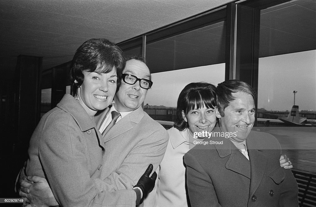 English comic duo <a gi-track='captionPersonalityLinkClicked' href=/galleries/search?phrase=Eric+Morecambe&family=editorial&specificpeople=215236 ng-click='$event.stopPropagation()'>Eric Morecambe</a> (1926 - 1984, left) and <a gi-track='captionPersonalityLinkClicked' href=/galleries/search?phrase=Ernie+Wise&family=editorial&specificpeople=211147 ng-click='$event.stopPropagation()'>Ernie Wise</a> (1925 - 1999) leave London Airport with their wives Joan (left) and Doreen, bound for the Montreux Festival in Switzerland, 26th April 1970.