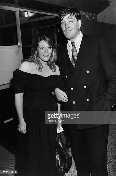English comic Stephen Fry with a young woman on his arm possibly his younger sister Jo 1989