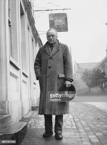 English composer and author Sir Arnold Bax Master of the King's Music outside the White Horse Hotel in Storrington Sussex 1942