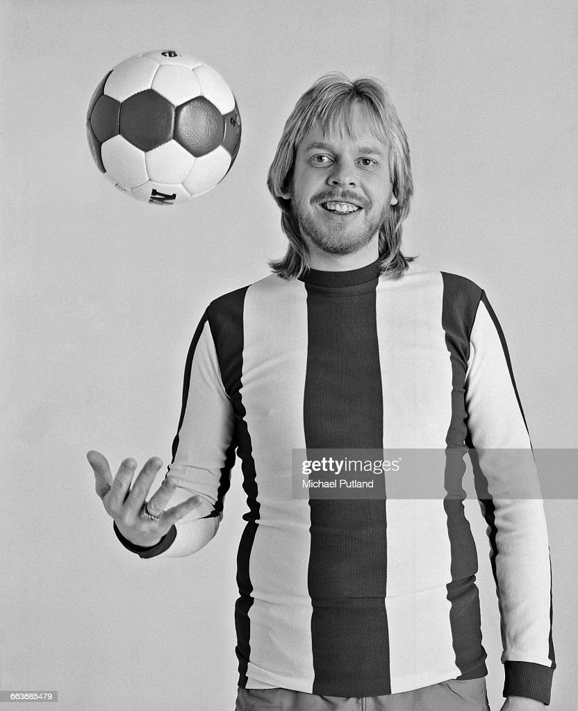English composer and keyboard player Rick Wakeman tossing a football, March 1983.