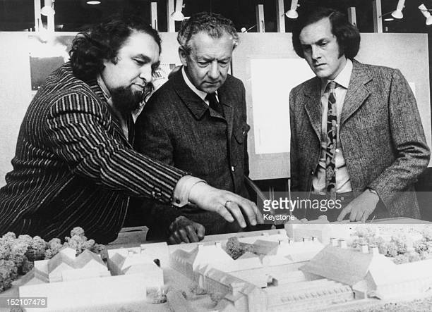 English composer Benjamin Britten and architectural engineers Ronald Marsh and John Braithwaite of Arup Associates inspect a model of the rebuilt...