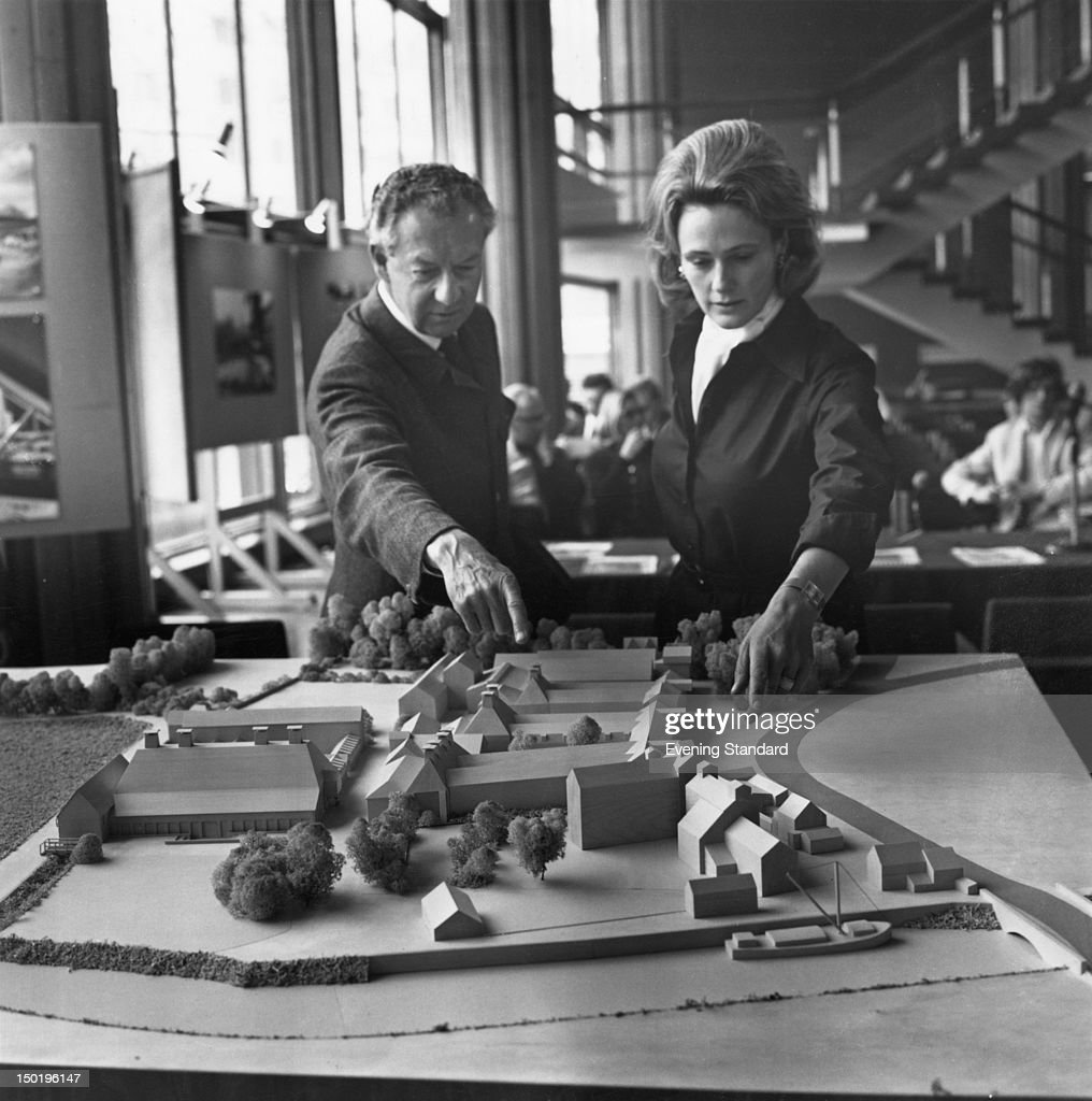 English composer Benjamin Britten (1913 - 1976) and Prudence Penn with a model of the Snape Maltings Concert Hall, 14th May 1970. The concert hall was established in Aldburgh, Suffolk, by Britten and singer Peter Pears in 1967.