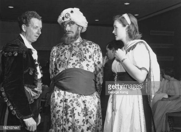 English composer Benjamin Britten with George Lascelles 7th Earl of Harewood and Mrs Anthony Lyttleton at an operathemed fancydress ball at the Royal...