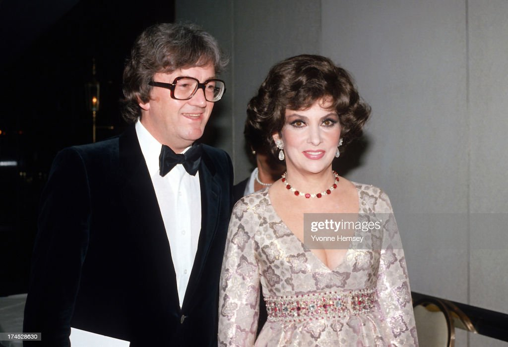 English composer, lyricist, and playwright Leslie Bricusse and actress Gina Lollobrigida are photographed at the wedding of Governor Hugh Carey and Evangeline Gouletas April 11, 1981 in New York City.