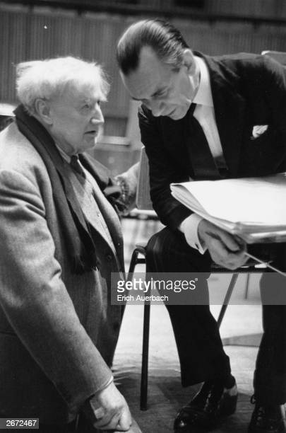 English composer Ralph Vaughan Williams has a word in the ear of conductor Sir Malcolm Sargent at a rehearsal for the world premiere of the 9th...