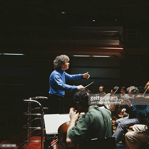English conductor Simon Rattle working with an orchestra 1993