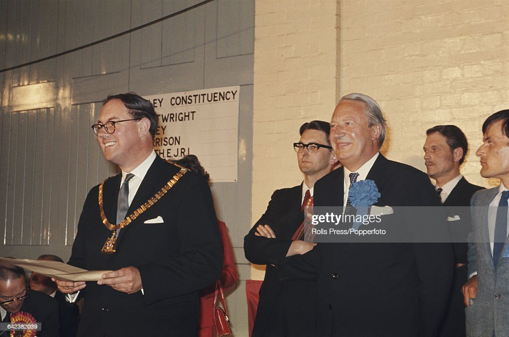 English Conservative party politician Edward Heath stands beside the Mayor of Bexley as he reads out the results of the Bexley constituency during...